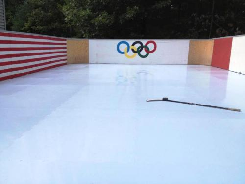 outdoor synthetic ice rink with panels in New York