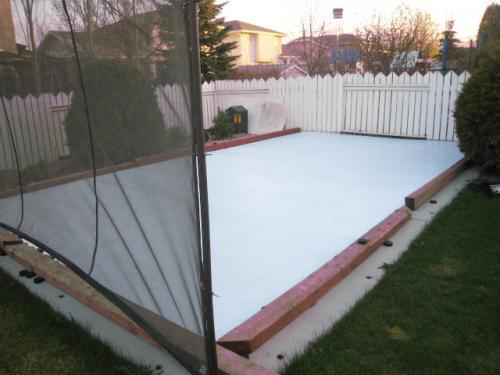 synthetic ice rink in backyard in winnipeg